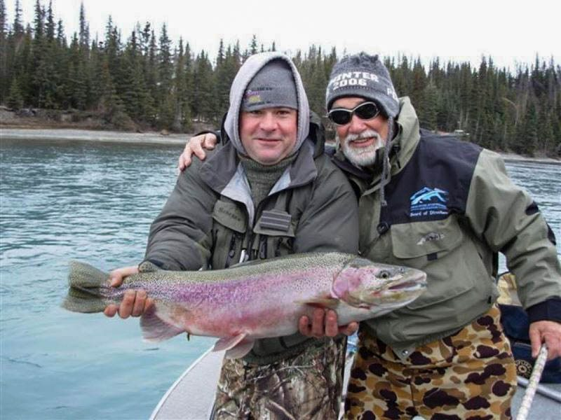 Captain Reubin Payne and client with a Kenai River Trout