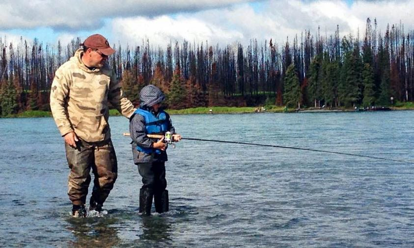 Captain Reubin Payne showing a young fisherman the ropes