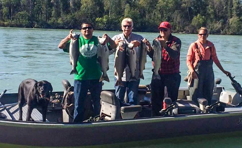 Alaska fishing guide client showing of their catch on the Kenai